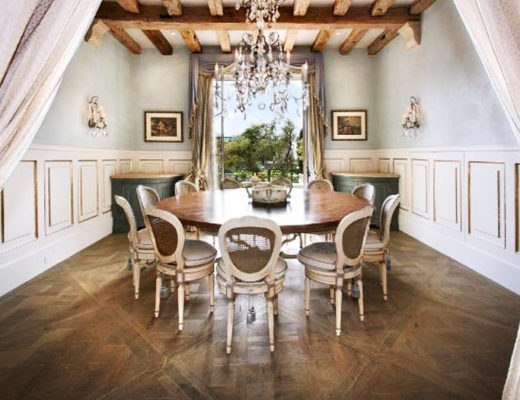gold dining room, gilded panels, wood beam ceiling